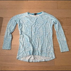 Long sleeve blue shirt.